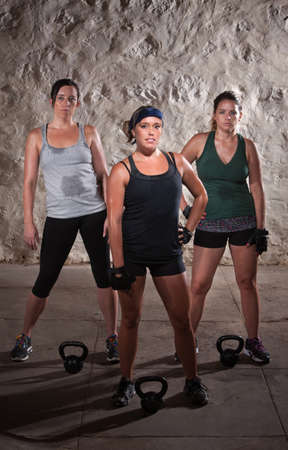 Pretty women pausing during a sweaty workout photo