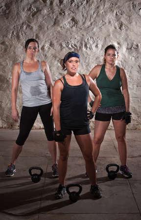 Pretty women pausing during a sweaty workout Stock Photo - 15934508
