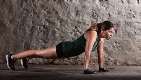 ups: Pretty young doing push ups and sweating
