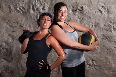 Happy young women with boot camp training equipment photo