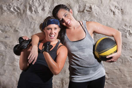 Happy boot camp training partners with weight and medicine ball photo