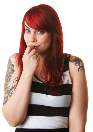 bashful: Bashful young white female with red hair and tattoo on arms