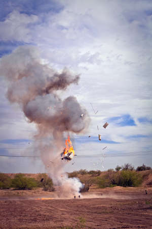 explosives: Movie special effects exploding appliance in a desert Stock Photo
