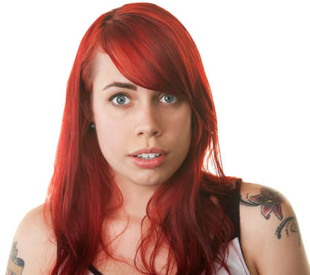 Shocked Caucasian lady in red hair on isolated background Stock Photo - 16190290