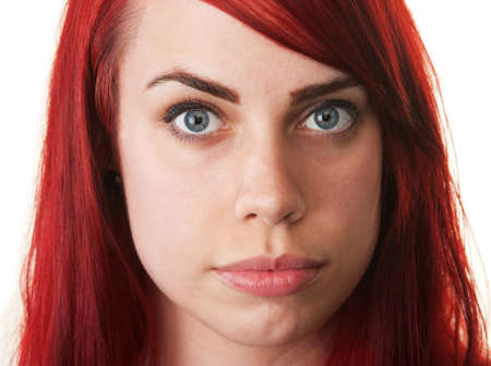 Serious smiling white woman with red hair on isolated background Stock Photo - 16190295