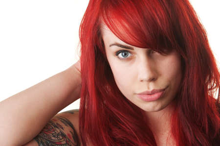 Beautiful woman with red hair and tattoo Stock Photo - 16190301