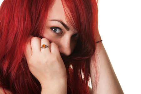 Young Caucasian woman covering her mouth with red hair Stock Photo - 16190297
