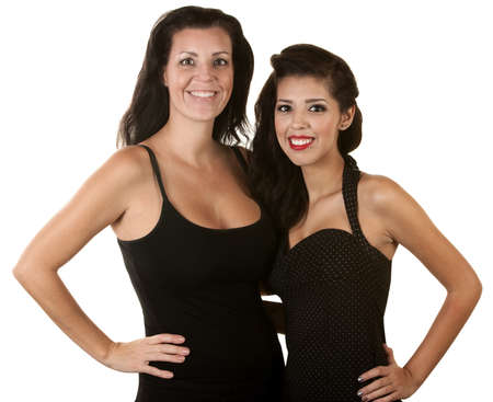 Pretty Hispanic mother and daughter over white background