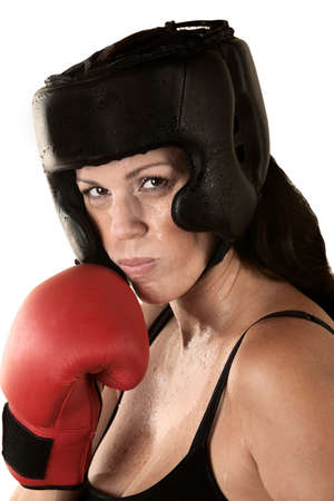 Sweating Hispanic female boxer with gloves and head protection Stock Photo - 16190302