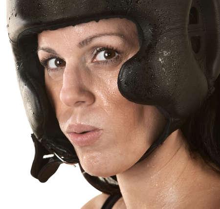 Close up of female Hispanic fighter sweating Stock Photo - 16190291