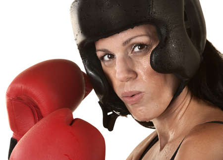 Sweating female adult boxer with gloves up over white Stock Photo - 16190294