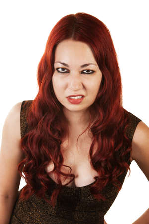 Grumpy Hispanic Woman with red hair over white background Stock Photo - 16300138