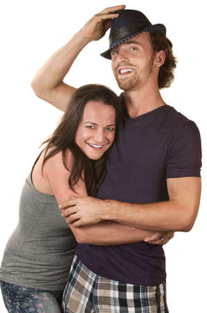 Happy European couple embracing over isolated background photo