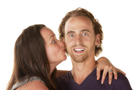Excited young man embraced and kissed by woman Stock Photo - 16300114