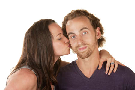 Calm bearded man kissed by woman over isolated background Stock Photo - 16300141