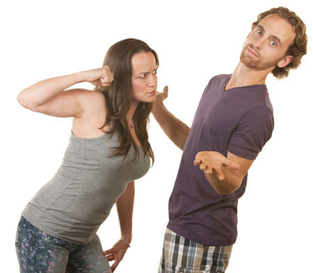 Suspicious woman threatening man with her fist Stock Photo - 16300085