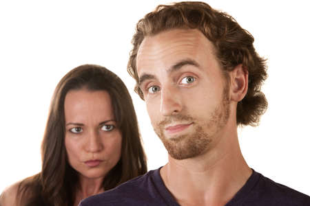 Sneaking male with suspicious woman behind him Stock Photo - 16300116