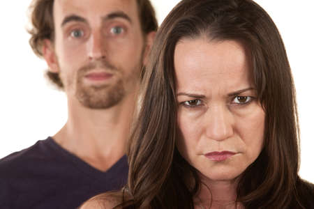 Angry Caucasian woman frowning with man behind her Stock Photo - 16300139