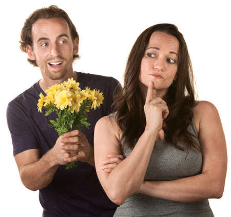 forgiving: Young woman thinking about forgiving man with flowers Stock Photo
