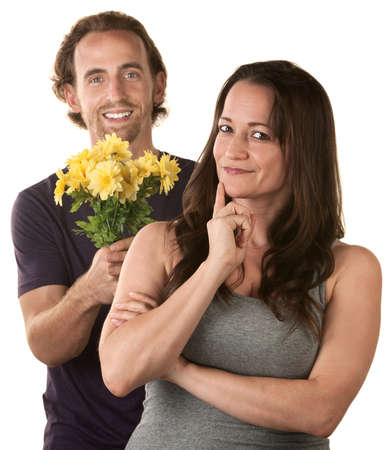 forgiving: Smiling woman and comforting man holding flowers Stock Photo