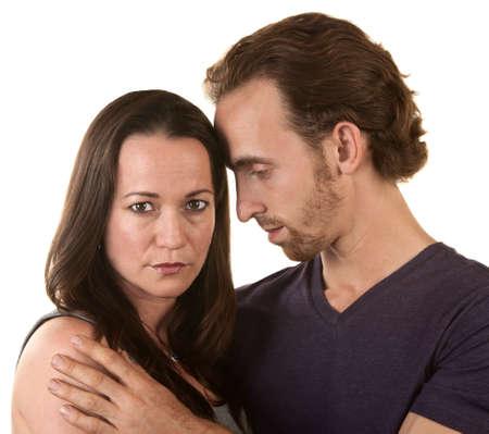 Sad couple embracing over isolated background Stock Photo - 16300096
