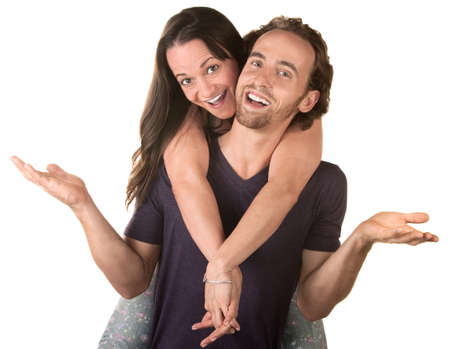 Happy woman riding the back of a smiling husband Stock Photo - 16300083