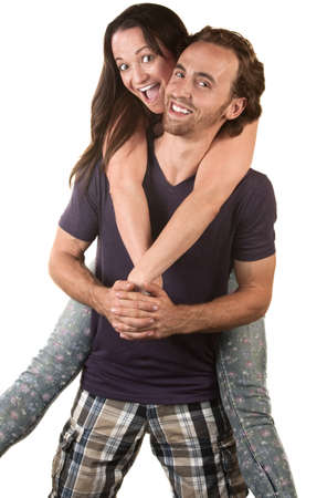 Joyful couple with woman riding the back of the man Stock Photo - 16300108