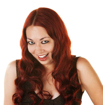 Giggling Mexican woman with curly red hair photo