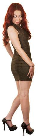 falda corta: Mujer hermosa en vestido corto y tacones altos