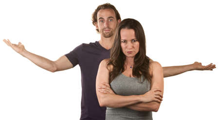 relationship problems: Frustrated young white couple over isolated background