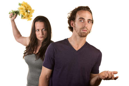 Woman ready to throw flowers at naive white male Stock Photo - 16473073