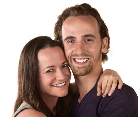 Smiling man and woman holding each other over white background Stock Photo - 16473121
