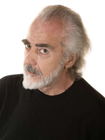 Mature bearded man in black looking suspicious photo