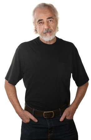 Serious mature man with hands in pockets over white background photo