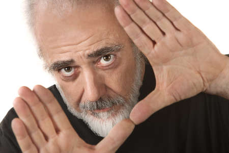 Isolated mature film director makes cropping gesture Stock Photo - 16473169