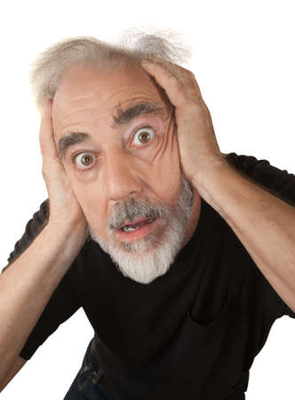 scared man: Paranoid older white man covering his ears Stock Photo