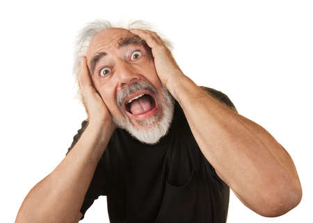 Screaming man covering his ears over white background
