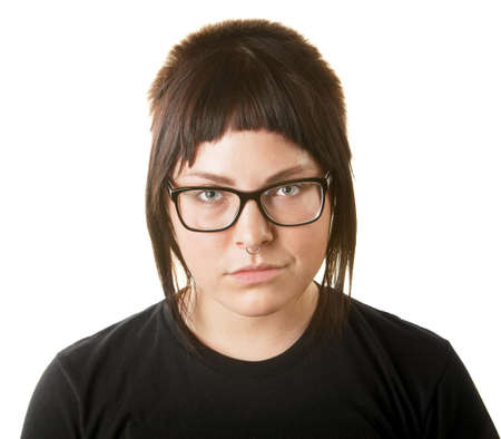 Sneering female adult with nose ring and eyeglasses photo