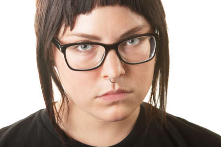 frowning: Serious young adult in black shirt and nose ring