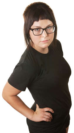 spiked hair: Serious young woman with hands on hips