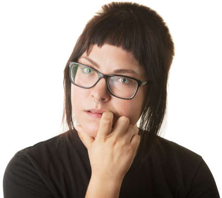 Young Caucasian woman staring and biting her fingernail Stock Photo - 16473047