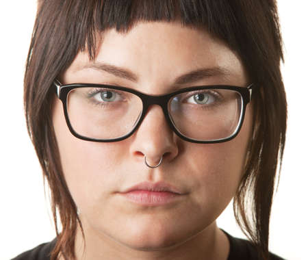 Close up of young woman with nose ring and eyeglasses photo