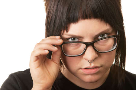 Serious female teenager looking over her eyeglasses Stock Photo - 16578040