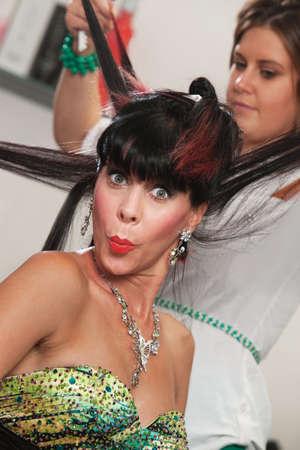 Woman in hair salon puckering her lips Stock Photo - 16578065