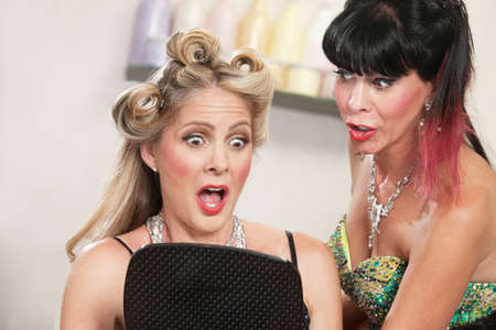 Two pretty women looking at a bad hairdo Stock Photo - 16578056