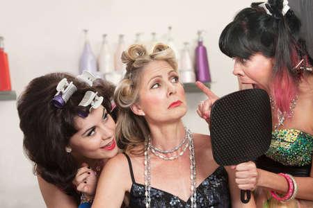 Emotional women talking about hair styles in beauty salon Stock Photo - 16578079