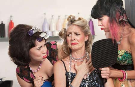 Sad white females in hair salon with mirror Stock Photo - 16578078