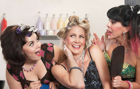Group of three happy women talking in hair salon Stock Photo - 16578055
