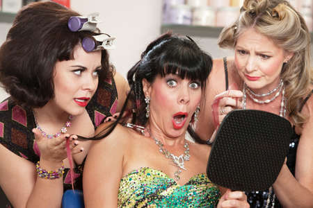 sympathetic: Shocked mature woman with sympathetic friends in hair salon