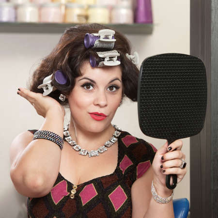 beauty parlor: Happy woman in curlers patting her new hairdo